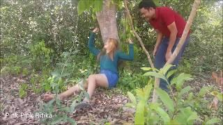 A man meets a girl sleeping alone in forest, A man takes picture of girl in forest