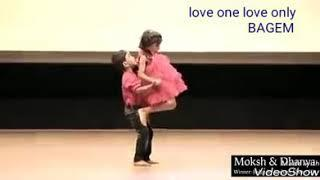 Little boy and girl dance