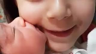 Cute Baby Girl Kissing lovely Sister. Nice Baby. Beautifull baby girl.